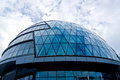 Modern building with glass dome exterior of blue cloudscape background Royalty Free Stock Image
