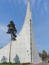 Modern building with pine tending to the sky tower of lauritsalan church lappeenranta finland Stock Photography