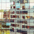 Modern building reflected on glass facade Royalty Free Stock Photo