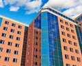 Modern buildings glass reflective city business office over blue sky with clouds Stock Photography