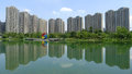 Modern buildings with lake in chengdu dayuan center park housings located china Stock Photos