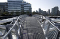 Modern buildings and pedestrian bridge vancouver a with unique designs connecting the in a new neighborhood Royalty Free Stock Image