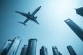 Modern buildings skyline with airplane Stock Image