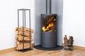 Modern burning stove wood logs rack Royalty Free Stock Photo