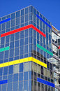 Modern business building detail of with colorful details and blue sky Stock Photography