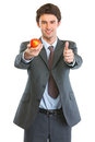 Modern business man showing apple and thumbs up Royalty Free Stock Photography