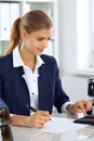 Modern business woman or confident female accountant in office. Student girl during exam preparing. Audit, tax service Royalty Free Stock Photo