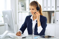 Modern business woman with headset in the office. Customer service operator at home work place. Success start up concept