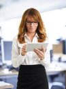 Modern business woman holding tablet businesswoman in the office Royalty Free Stock Images