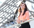 Modern business woman standing on the balcony of a modern office building Royalty Free Stock Photo