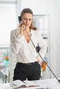 Modern business woman talking phone in office Royalty Free Stock Photo