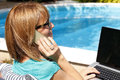 Modern business woman working at home sitting garden with phone and laptop small Royalty Free Stock Photo