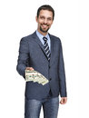 Modern businessman giving stack of dollars isolated on white happy smiling young man in a suit jacket stretches one hundred dollar Stock Image