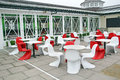 Modern cafe seating area photo of with red and white bucket seats located at herne bay seafront in kent Royalty Free Stock Images