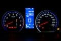 Modern Car Speedometer and Illuminated Dashboard Royalty Free Stock Photo
