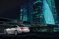 Modern car stand near Moscow City district at night Royalty Free Stock Photo
