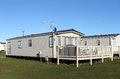 Modern caravan home trailer park blue sky background Royalty Free Stock Photos