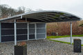 Modern carport car garage parking made from black metal and glass Stock Photography