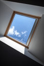 Modern ceiling fragment with window and blue sky behind it Royalty Free Stock Image