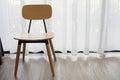 Modern chair on white drape texture background. Royalty Free Stock Photo