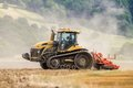 Modern Challenger  tractor cultivating English crop field Royalty Free Stock Photo