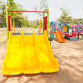 Modern children playground in city park under sunny light Royalty Free Stock Image