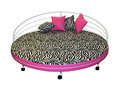 Modern circle bed zebra pattern upholstery pink decorative pillows Royalty Free Stock Photo