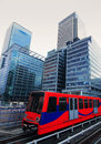 Modern city london canary wharf with train Stock Photo