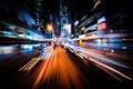 Modern city motion blur hong kong abstract cityscape traffic background with art toning moving through street with illuminated Stock Images