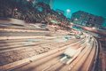 Modern city at night fast moving cars in Stock Image