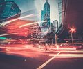 Modern city at night fast moving cars in Royalty Free Stock Photography