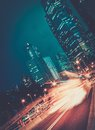 Modern city at night fast moving cars in Stock Images