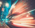 Modern city at night fast moving cars in Royalty Free Stock Images