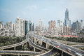 Modern city skyline with interchange overpass and elevated road junction in shanghai Royalty Free Stock Photo