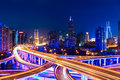 Modern city skyline with interchange overpass at night Royalty Free Stock Photo