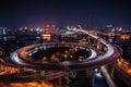 Modern city traffic road at night. Transport junction.