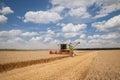 Modern combine (harvester) harvesting on wheat field Royalty Free Stock Photo