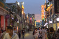 Modern commercial city street, urban shopping street with crowded people, street view of China