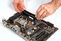 Modern computer mother board assembly, memory installation. Royalty Free Stock Photo