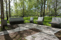 Modern concrete benches and path in a public park. Royalty Free Stock Photo