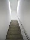 Modern concrete indoor staircase the way upwards via an Royalty Free Stock Photos