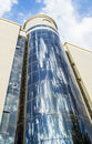 Modern cylindrical building glass wall of of this blue sky and clouds reflection Stock Photography