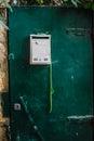 Modern Dark green emerald metal dirt door with keyhole and rusty metal lockas a beautiful vintage background Royalty Free Stock Photo
