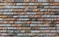 Modern decorative colored stone brick wall background Royalty Free Stock Photo