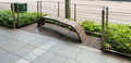 Modern design bench beside the street wooden on pathway Stock Photography
