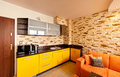 Modern design orange yellow theme room corner mounted kitchen sandstone tiled wall Stock Photos