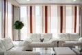 Modern designed minimalistic interior of livingroom in simple apartment Stock Image