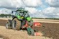Modern deutz fahr tractor pulling a plough