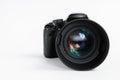 Modern digital photo camera with 85 mm photo lens Royalty Free Stock Photo