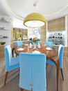 Modern dining room with kitchen in a trendy style kitsch. Royalty Free Stock Photo